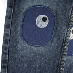 two iron-on patches for repairing holes and tears, blue with a pair of embroidered eyes