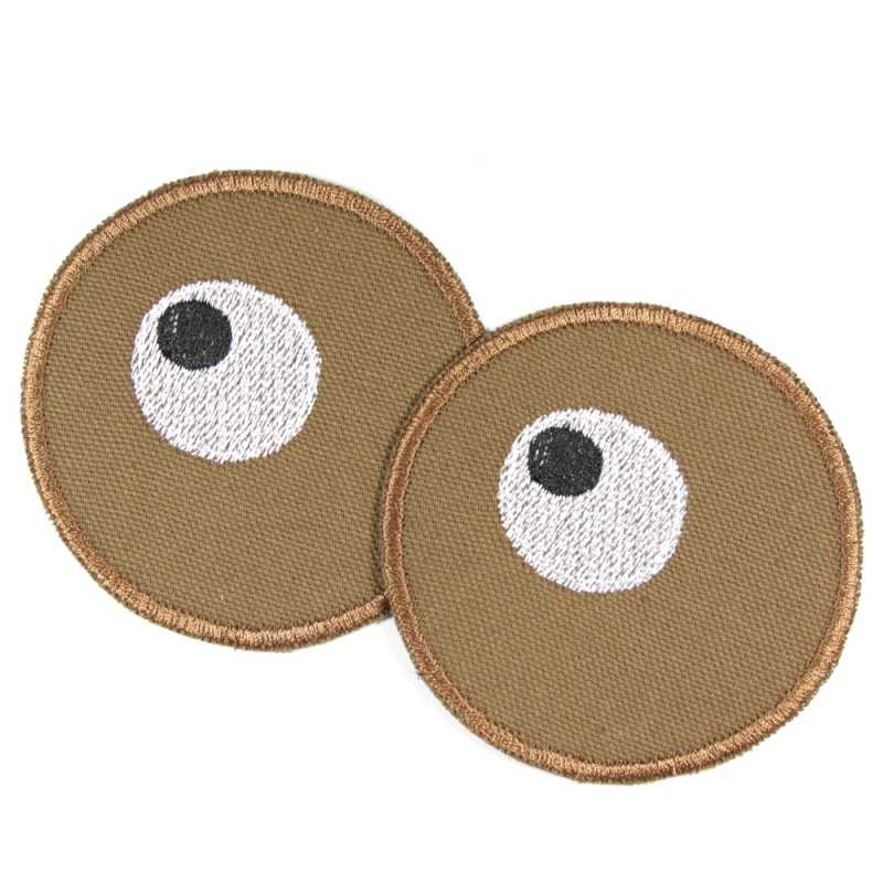 2 round iron-on patches with eyes embroidered on brown organic cotton