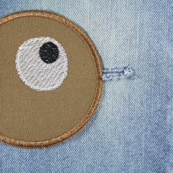 textile repair patches as iron-on patches with eyes for children's trousers