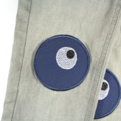 two repair patches for ironing on and covering holes and tears, blue with embroidered eyes