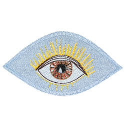 Iron-on patch eye with brown iris embroidered on light blue jeans