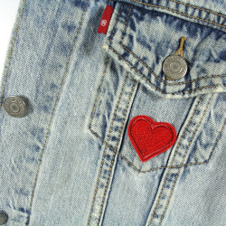 Two small hearts iron-on patch with glitter metallic thread as an accessory or iron-on patch